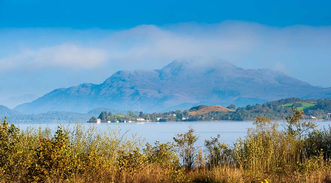 Early mist clears Loch Lomond in Autumn